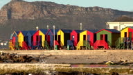 Zoom out of brightly coloured changing rooms and tidal pool,St. James beach,Cape Town video