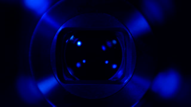Zooming camera lens video