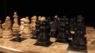 Zooming in at a chess board and its pieces on it video