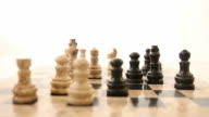 Zooming in at a chess board and its pieces, the white king is in focus video