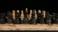 Zooming in of a chess board and its pieces lined up, the focus is on white pieces video