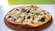 Zooming in to Pizza on a White Wooden Table in a Cafe video