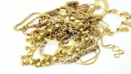 Zooming into gold jewelry PHOTO video
