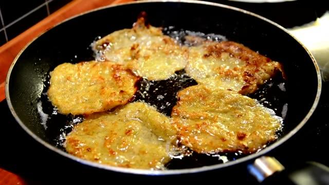 Zucchini pancake frying video