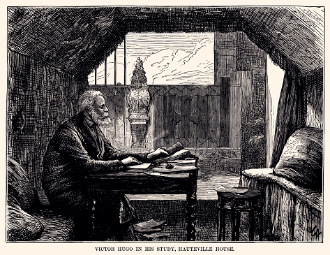 VICTOR HUGO IN HIS STUDY, HAUTEVILLE HOUSE (GUERNSEY).  Victor-Marie Hugo (26 February 1802 – 22 May 1885) was a French poet, novelist, and dramatist of the Romantic movement. Vintage engraving circa late 19th century.