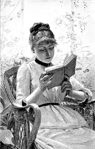 19th century engraving of a pretty young lady sat in a wicker chair reading her book; Victorian women and literature 1890