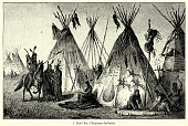 Vintage engraving of Village of Cheyenne Indians. The Cheyenne are one of the groups of indigenous people of the Great Plains and their language is of the Algonquian language family. Ferdinand Hirts Geographische Bildertafeln,1886.