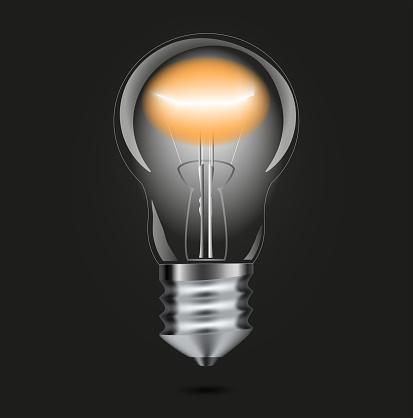 3d image, illustration. Realistic backlit incandescent lamp on a black background. Electricity.