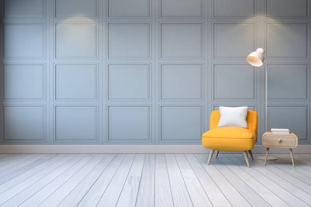 3d interior Modern interior,yellow arm chair with wood table and white lamp on light gray wall ,3d rendering interior designer stock illustrations