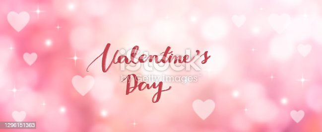 abstract blur beautiful pink color gradient and shine glowing background with valentine's day calligraphy message for 14 february season of love concept