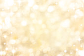 abstract blur beautiful soft bright metal gold color background with circle bokeh light and shinning star for christmas festival and happy new year season collection design as banner concept