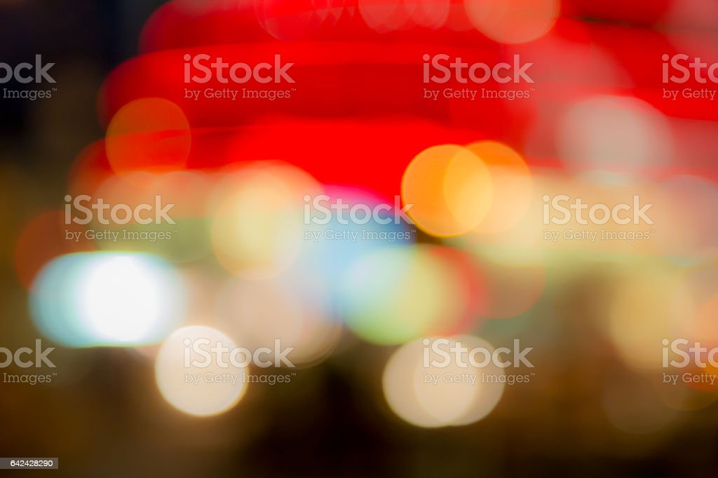 Abstract blurred colored background. The lights of the illumination lights or street lights in a blur. Bokeh and defocusing vector art illustration