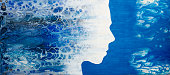 istock Abstract painting with liquid acrylic. Profile of the girl from the sea foam. 1141969161