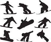 Agile snowboarders snowboarding