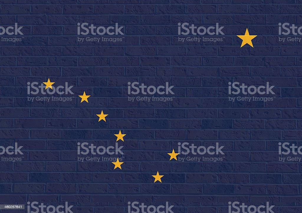 Alaska State Flag on brick wall vector art illustration