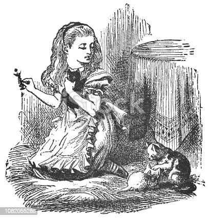 istock Alice holding a Chess Piece and Playing with her Kittens in Through the Looking-Glass 1082055288