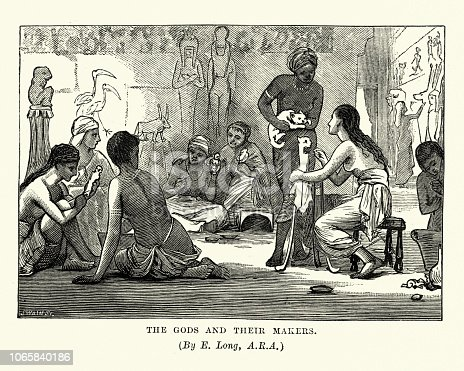 Vintage engraving of Ancient Egypt, The Gods and their Makers.  Priestess' craving statues of Egptian Gods and Cats