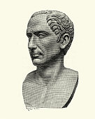 Vintage engraving of a Bust of Julius Caesar. a Roman politician and military general who played a critical role in the events that led to the demise of the Roman Republic and the rise of the Roman Empire.