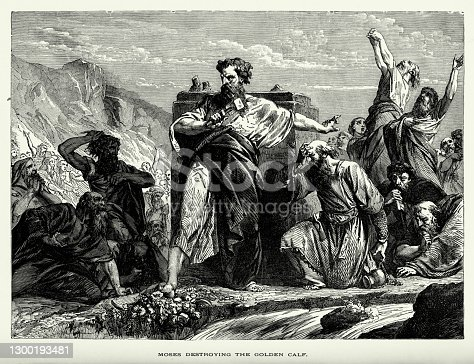 Engraved illustration of Moses Destroying the Golden Calf Engraving from The Popular Pictorial Bible, Containing the Old and New Testaments, Published in 1862. Copyright has expired on this artwork. Digitally restored.