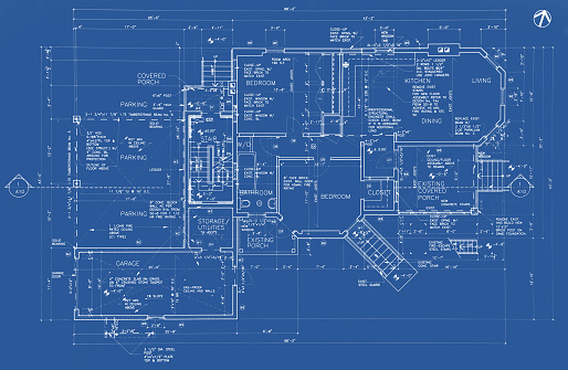 This is a photo of an architecture drawing (blueprint) depicting the main floor of a house.