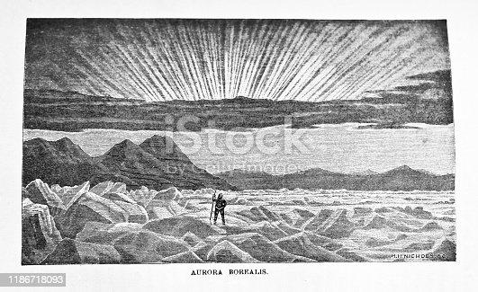 istock Aurora Borealis, Phenomenon of polar Seas at Nothern Daybreak, Black and White Engraving, Figure in Foreground 1186718093
