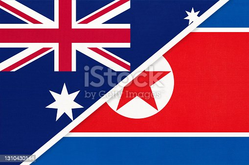 istock Australia and North Korea or DPRK, symbol of national flags from textile. 1310430144