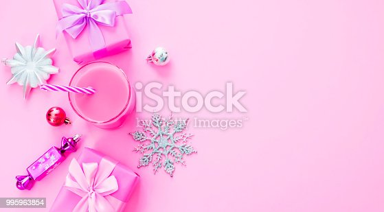 Banner Decorative background Christmas composition Flat lay box gift ribbon bow snowflake cocktail pink. Top view copy space