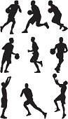 Basketball players fastbreak