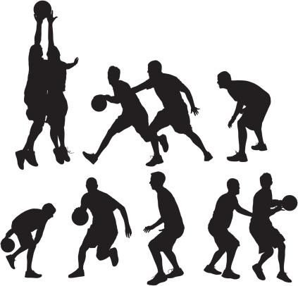 Basketball players playing ball