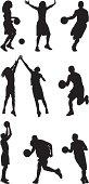 Basketball players playing street ball