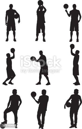 Basketball players posing with basketballs