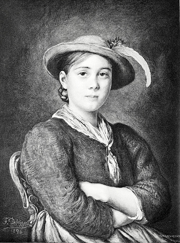 Bavarian girl portrait with hat and crossed arms, sitting on chair