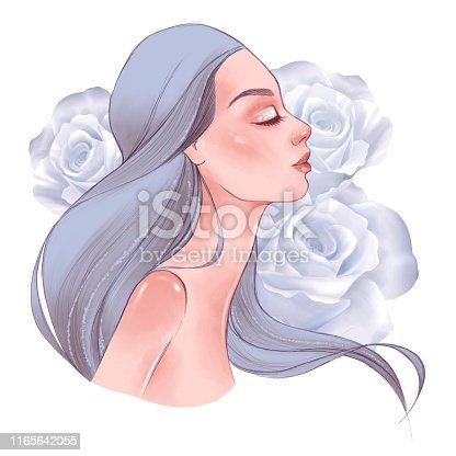 istock Beautiful girl smelling roses 1165642055