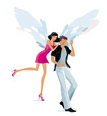 Beautiful girl with the wings of the angel makes an unexpected surprise to her man, closing his eyes with hands over. Date and love.