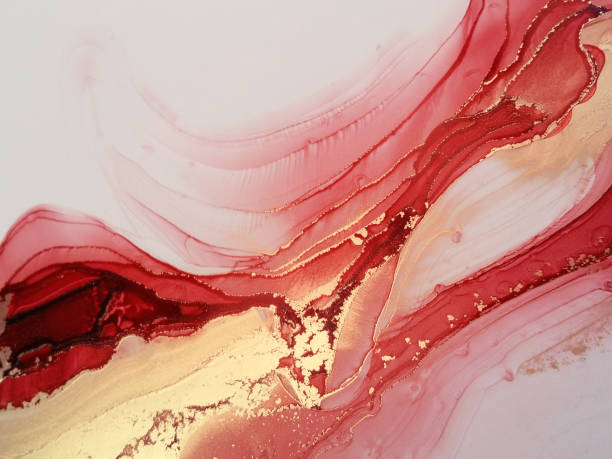 Beautiful luxury abstract fluid art painting in alcohol ink technique, mixture of red and gold paints. Imitation of marble stone cut, glowing golden veins. Tender and dreamy design. Hand painted watercolor fluid art painting in alcohol ink technique. marble rock stock illustrations