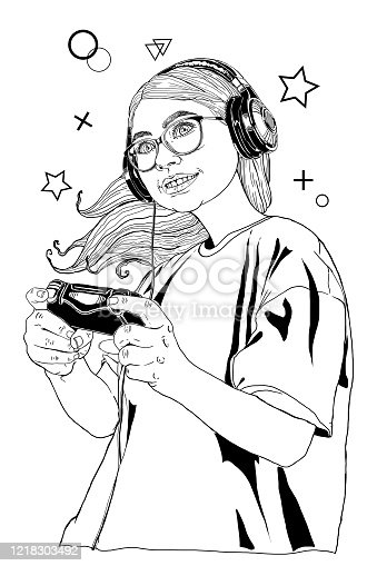 Beautiful young woman gamer in black headphones with a joystick in her hands