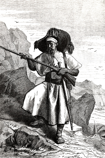 Berber man from the Kabylen holding rifle, in the mountain