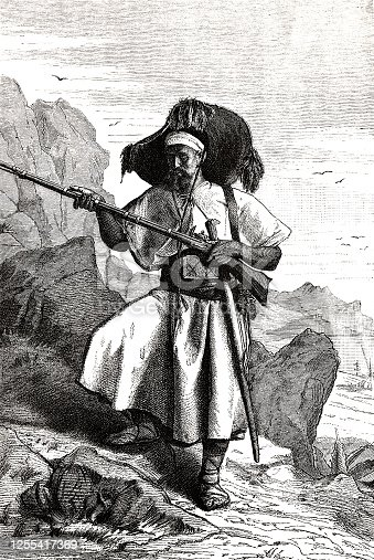 istock Berber man from the Kabylen holding rifle, in the mountain 1255417369