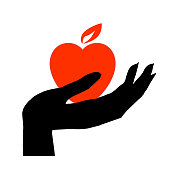 istock Black hand holds a burning heart in its palm 1315456498