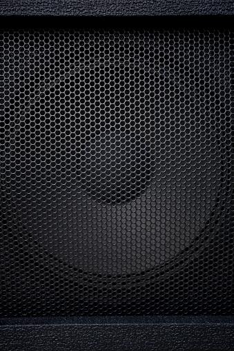 Black speaker grille on white background
