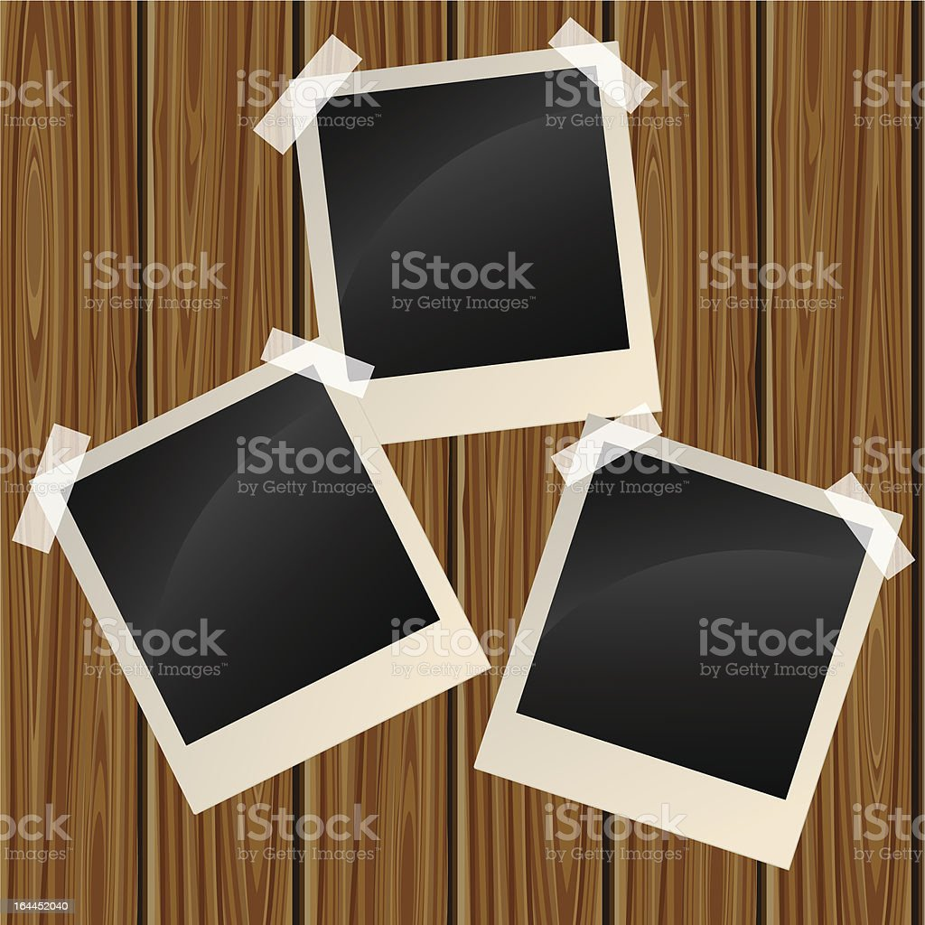 Blank photos on a wooden wall royalty-free stock vector art