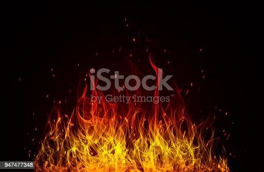 istock Blazing flames over black background 947477348