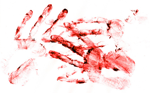 Bloody handprints on white paper