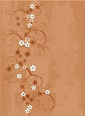 An ochre toned background with a hint of grunge-sort of fresco style floral decoration.
