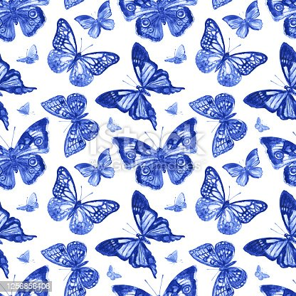 istock Blue butterflies seamless pattern on a white background 1256856406