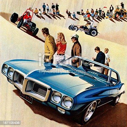 Blue Car on Sand Dunes