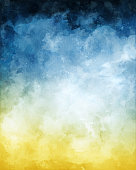 A watercolor abstraction of clouds and fog on a textured paper background and toned with a blue to yellow gradient.  Image displays a paper texture at 100%.
