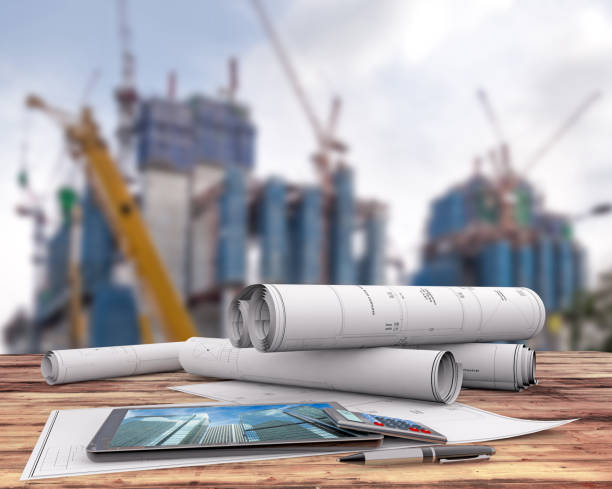 blueprints and tablet in the construction site - mieszkanie komunalne stock illustrations