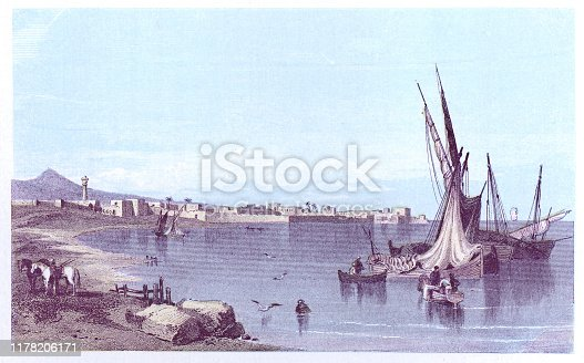 Boats in the harbour at Tyre, Lebanon. Vintage colour etching circa mid 19th century.