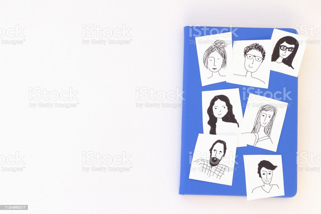 book with faces vector art illustration